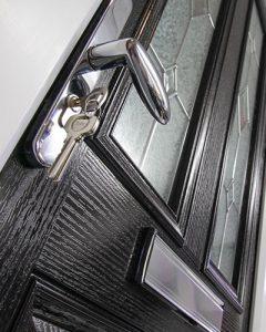 Black composite door close up of handle