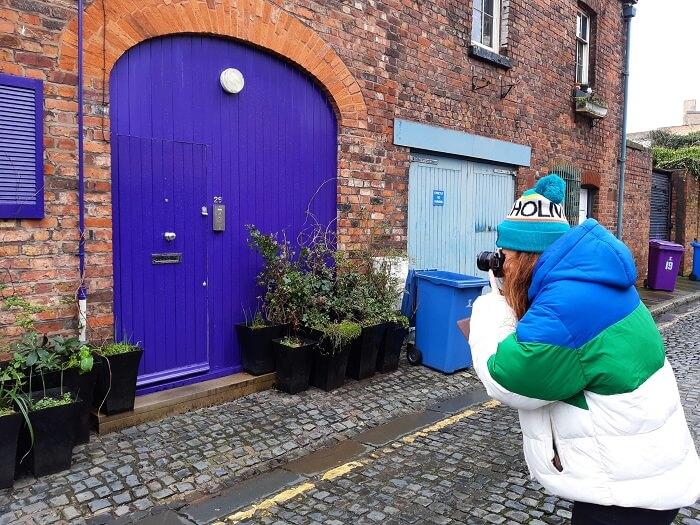 Photograph being taken of blue door