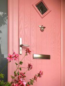 Close up of pink composite front door