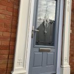 Light grey composite front door with traditional glazing