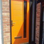 Orange front door installed in Formby